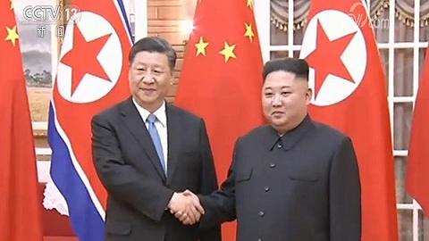 习近平同金正恩举行会谈:中朝双方愿不忘初心、携手前进