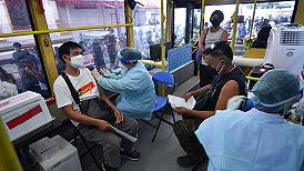 美国将放宽国际航班旅客入境限制,印度下月起恢复疫苗出口 | 国际疫情观察(9月21日)